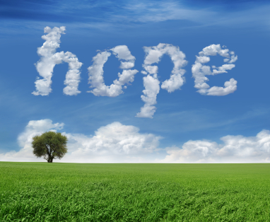 photo the word hope written in a blue sky